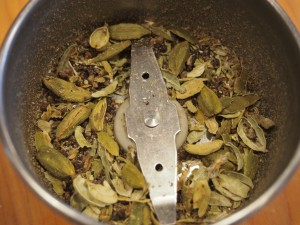 Cardamom pods after a couple pulses in the spice grinder